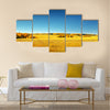 Autumn landscape. Yellow field and blue sky Multi panel canvas wall art