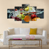 Fresh Fruit and Vegetables being shot as they submerged under water Multi panel canvas wall art