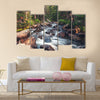 Dreamy mountain stream flowing through forest between boulders Multi Panel Canvas Wall Art