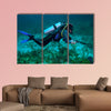 Spear fisherman with spear gun Multi panel canvas wall art