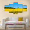 Rapeseed field with forest far away Multi panel canvas wall art
