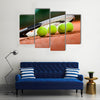 Close up view of tennis racket and balls on the clay tennis court Multi panel canvas wall art