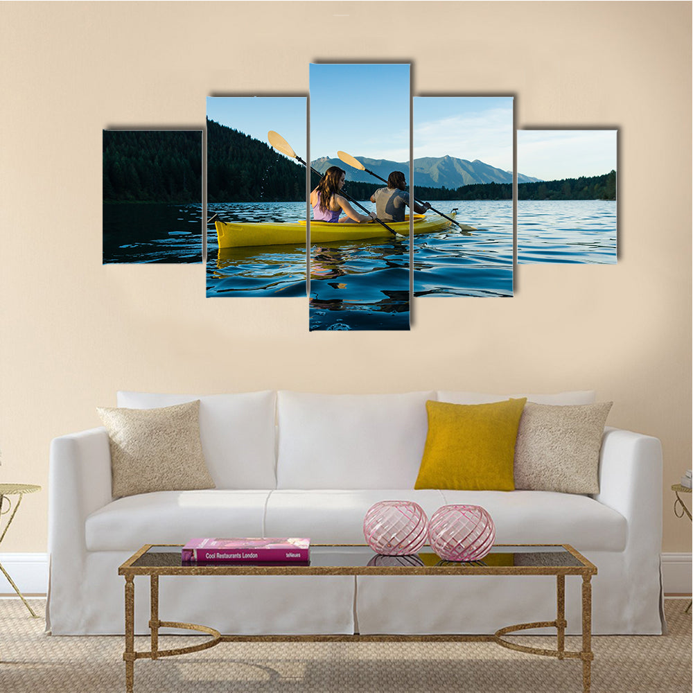 Couple Paddling In kayak On Lake Multi Panel Canvas Wall Art