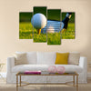 Golf ball on tee in front of driver on a gold course Multi Panel Canvas Wall Art