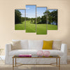 Beautiful golf fairway lined with trees Multi Panel Canvas Wall Art
