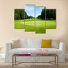 Green golf field with sky Multi Panel Canvas Wall Art