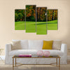 Golf course putting green with flag in autumn colors Multi Panel Canvas Wall Art