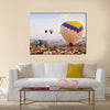 Hot air balloon flying over rock landscape at Cappadocia Turkey, multi panel canvas wall art