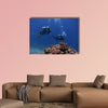 The two divers with bubbles coral reef in the red sea Multi panel canvas wall art