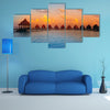 The Houses On Piles On Water At The Time Of Sunset Multi Panel Canvas Wall Art