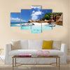Speed boat on the beach of coco island, Seychelles Multi panel canvas wall art