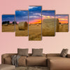 End of day over field with hay bale in Hungary multi panel canvas wall art