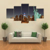 Manhattan Skyline and the Statue of Liberty at Night, New York City Multi panel canvas Wall art