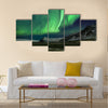 Flash of Aurora polaris above mountains Multi panel canvas wall art