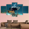 Young Man Scuba Diver between Water Surface near a turtle Multi panel canvas wall art