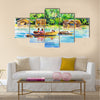 Landscape with boat on a river and village Multi panel canvas wall art