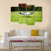 Golf ball on tee in front of driver Multi Panel Canvas Wall Art