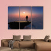 Silhouette of a man on a rock Multi panel canvas wall art