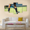 The strong white legs of a sportive young woman playing Hockey sport Multi panel canvas wall art