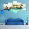 Over water bungalows in blue sea watercolor Multi Panel Canvas Wall Art