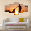 Creative man with his yellow labrador retriever in nature - back lit Multi panel canvas wall art