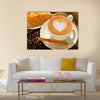 A cup of cafe latte with coffee beans and puff pastry Multi Panel Canvas Wall Art
