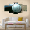 A white leather stitched cricket ball hitting a wooden cricket bat Multi Panel Canvas Wall Art