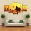 Silhouettes Of The Traditional Fishermen At The Sunset Near Galle In Sri Lanka Multi Panel Canvas Wall Art