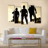 Silhouettes of SWAT officers holding their guns Multi Panel Canvas Wall Art