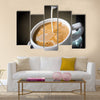 Pouring cream into a cup of coffee Multi Panel Canvas Wall Art