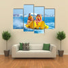 Happy People having Fun on Banana boat Multi Canvas Print Wall Art