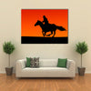 Silhouette of a Horse and Rider at Sunset. Multi Panel Canvas Wall Art