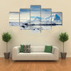 Beautiful snow-capped mountains against the blue sky in Antarctica Multi panel canvas wall art