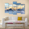 Alpine landscape with peaks covered by snow and clouds Multi panel canvas wall art