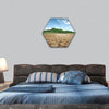 Cracked earth concept image of global warming hexagonal canvas wall art