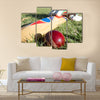 Cricket ball bat and gloves on the field Multi panel canvas Wall art