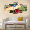 Cricket ball, bat and gloves on the field Multi panel canvas Wall art