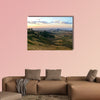 Mountain landscape. Cloudy sky illuminated by the sunset. Africa, wall art