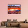 Sunrise at iconic Mesa Arch in Canyonlands National Park Multi panel canvas wall art