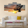 Three satellite dishes over sunset Multi panel canvas wall art