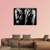 Bodybuilding strong man and a woman posing on a black background Multi panel canvas wall art