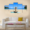Yoga woman on sea coast Multi panel canvas wall art