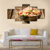 Heaped rustic bowl of savory quinoa with herbs, peppers and tomato Multi panel canvas wall art