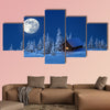 A wooden house in winter forest multi panel canvas wall art