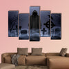 Faceless angel of death in loose overall among graves in the cemetery multi panel canvas wall art