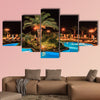 Tropical swimming pool in night view multi panel canvas wall art