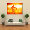 Basketball player silhouette dribbling with lights Multi panel canvas wall art
