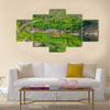 A whitetail deer doe crossing a creek in the summer Multi Panel Canvas Wall Art