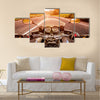 Biker driving a motorcycle rides along the asphalt road. First-person view Multi panel canvas wall art