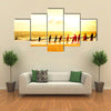 Local Fishermen Pull Net From The Ocean In Hikkaduwa, Sri Lanka Multi Panel Canvas Wall Art